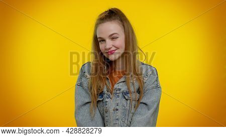 Smiling Playful Happy Stylish Teen Girl In Denim Jacket Blinking Eye, Looking At Camera With Toothy