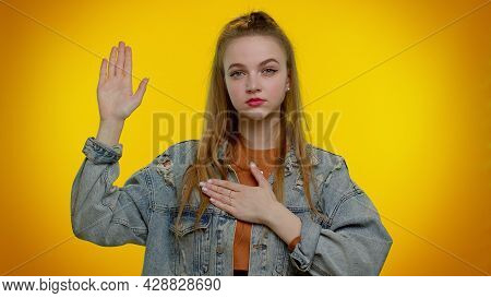I Swear To Be Honest. Sincere Responsible Teen Student Girl Raising Hand To Take Oath, Promising To