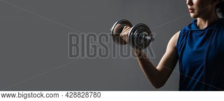 Selective Focus Steel Dumbbell On Hand Of Asian Woman Workout With Lifting Weight On Web Banner Grey