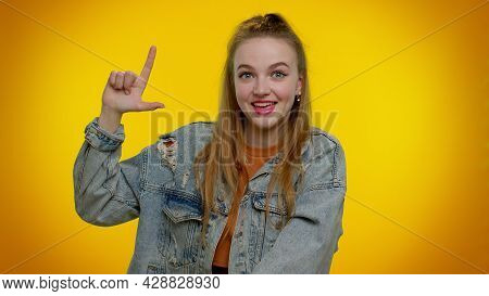 Teen Stylish Girl Showing Loser Gesture And Pointing On You, Blaming Accusing For Unsuccess, Express