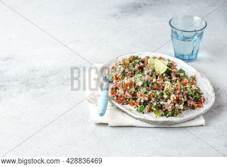 Tabbouleh Salad Is A Traditional Middle Eastern Or Arab Dish. Vegetarian Salad With Parsley, Mint, B