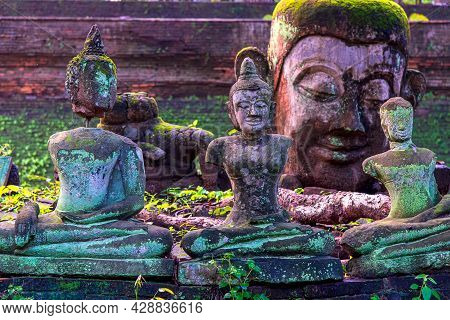 Ancient Wreckage Buddha Statue At U Mong Temple In Chiang Mai, Thailand.