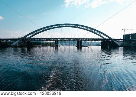 Steel Structure Of The Arch Of The Bridge Over The Dnieper River In Kiev. View Of The Bridge From Th