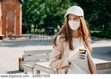 Food And Drink Businesses During Coronavirus Pandemic. Coffee To Go Takeaway Cup In Female Hands In