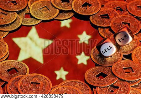 The Flag Of China Surrounded By Feng Shui Coins. Dices With The Words Sell Buy On The Edges. The Con