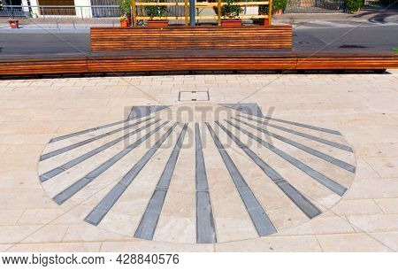 The Scallop Symbol Of The Pilgrims Of Santiago De Compostela Represented On A Sidewalk Along The Lig