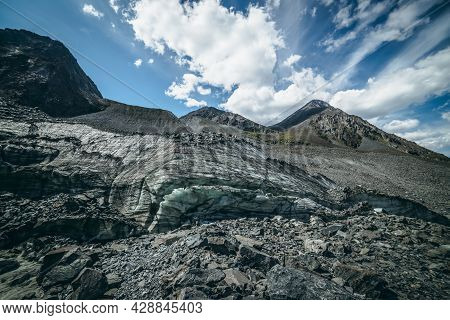 Scenic Highlands Landscape With Big Glacier And High Mountain Top In Pyramid Shape In Sunny Day. Awe