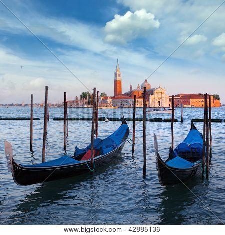 Gondolas and San Giorgio Maggiore church on Grand Canal in Venice