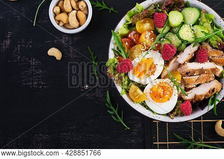 Grilled Chicken Meat And Fresh Vegetable Salad Of Tomato, Cucumber, Egg, Lettuce And Raspberry. Keto