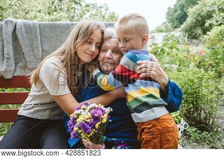 Reunited, Family, Togetherness, Relationships, Meeting, Embracing. Grandson And Granddaughter Visit