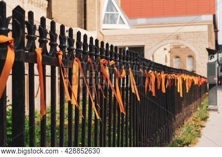 Orange Ribbons Tied To A Wrought Iron Fence Outside Saint Mary's Cathedral, Winnipeg, Manitoba, Cana