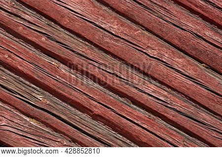 Background Of Falun Red Logs. Diagonal Wooden Backdrop