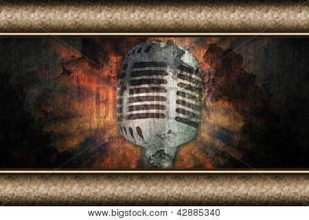 Microphone over grunge background