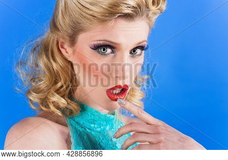 Young Woman With Pin-up Make-up And Hairstyle. Beauty, Fashion. Cosmetics. Close Up Portrait.