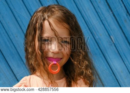 A Cute Girl With A Vestibular Hard Mouth Guard Plate For Correcting The Bite Of Teeth In Orthodontic