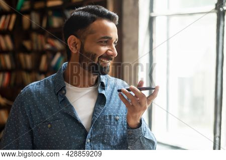 Handsome Young Indian Man In Smart Casual Wear Recording And Sending Voice Message, Mixed Race Male