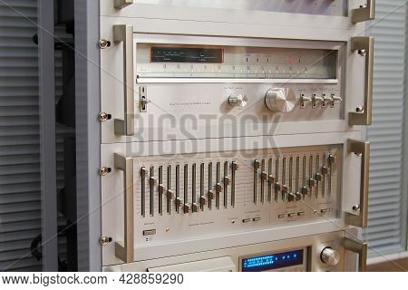 An Analog Stereo Tuner And An Analog Stereo Equalizer Installed In A Retro Hardware Rack.