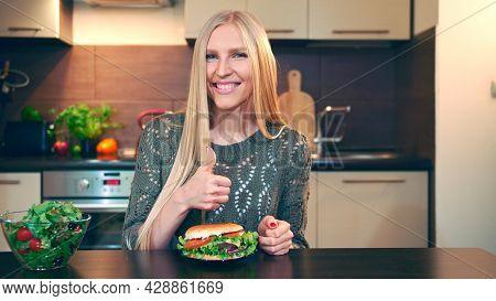 Young Woman Preferring Hamburger To Salad. Attractive Young Woman Choosing To Eat Healthy Hamburger