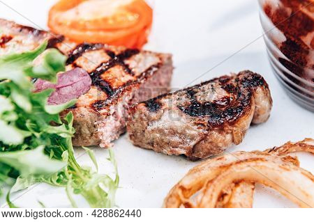 Superb Flavoured And Tender Fried Sirloin Steak Served With Triple-cooked Fries, Homemade Onion Ring