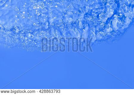 Serum Texture Close Up. Clear Blue Liquid Gel Background. Transparent Beauty Skincare Product Sample