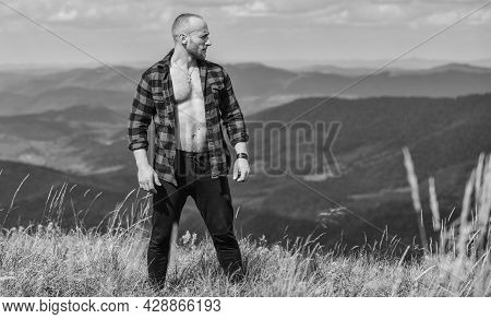 Man Stand Top Mountain Landscape Background. Athlete Guy Relax Mountains. Beautiful Environment. Mus