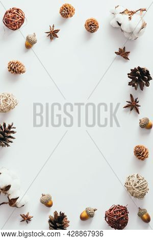 Autumn Frame Made Of Acorns, Pine Cones, Cotton On White Background. Flat Lay, Top View. Autumn Fall