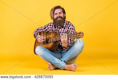 His New Song. Relax With Favorite Music. Guy With Guitar Performing Song. Guitar Player On Yellow Ba