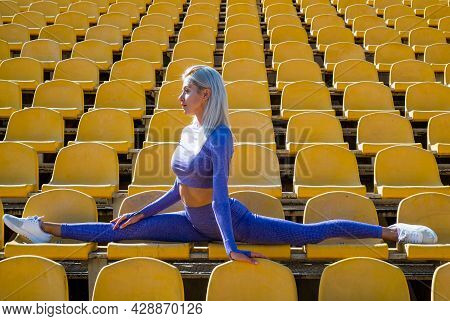 Split. Sport And Fitness. Sexy Woman In Sportswear. Athletic Girl On Outdoor Stadium.
