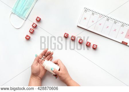 Text Long Covid On Red Cubes. Hand With Pills, Weekly Planner, Calendar With All Days Crossed Out. C
