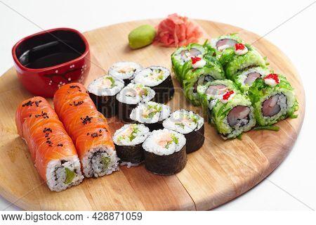 Sushi Bar Set - International Maki Sushi Roll On Black Slate Platter. Served With Wooden Chopstick,