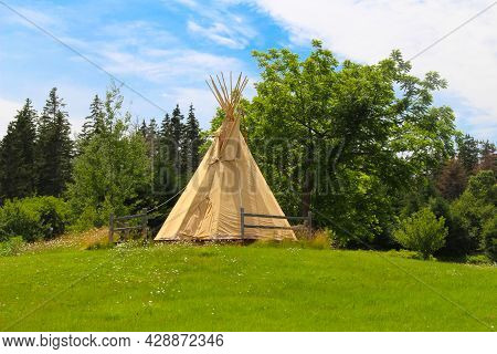 Teepee Structure Amongst Green Grass In New Brunswick Canada