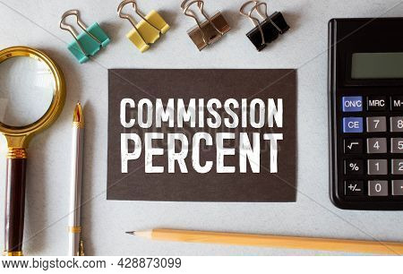 The Word Commission Written On White Paper Sheet With Hundred Dollar Bills. Business Concept.