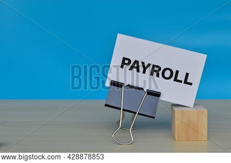 White Paper With Text Payroll Isolated On Blue Background
