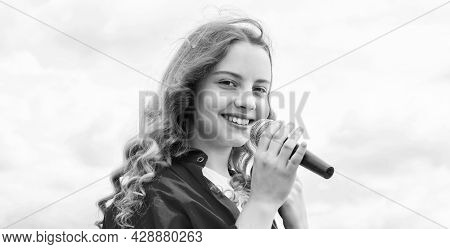 Music And Life. Teen Girl Singing Song With Microphone. Having A Party. Happy Kid With Microphone. K