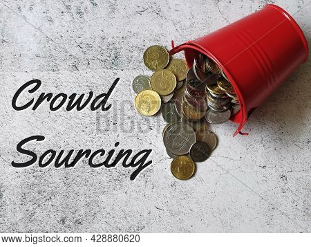 Phrase Crowd Sourcing On Tile Surface With Coins And Bucket. Business And Finance Concept.