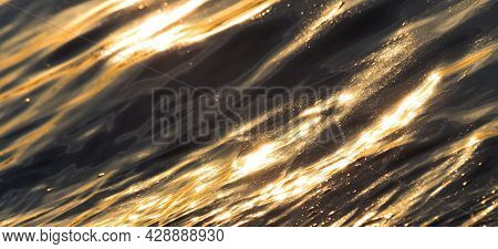 Abstract Water Background Of Sea Golden Waves With Sunny Reflections. Banner.