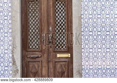Travel To Portugal. Old Vintage Facade And Door From House Exterior In Portuguese Typical Traditiona