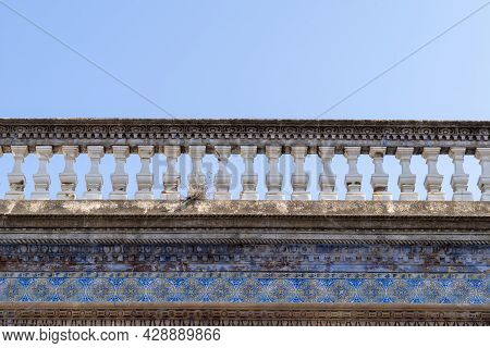 Travel To Portugal. Old Vintage Facade And Balcony From House Exterior In Portuguese Typical Traditi