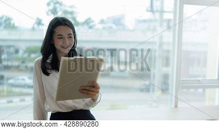 Banner Wide Image, Happy Asian Young Businesswoman Reading Company Information, Report Income In The