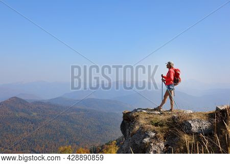 Female Tourist On Top Of A Hill In Silence And Loneliness Admires A Tranquil Natural Landscape In Se