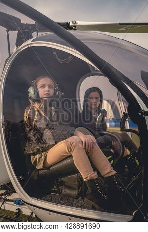 Two Dreamy Tween Girls On Pilot Seats In Helicopter Cockpit