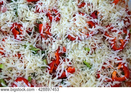 Raw Pizza With Grated Cheese Top View