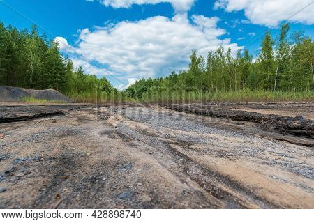 The Bottom Of The Dried Up River In Summer Is Made Of Sand, Clay And Black Stones. Lowland Next To T
