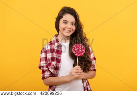 Sweet Tooth. Yummy. Happy Girl Hold Lollipop. Lollipop Child. Hipster Kid Hold Lollypop.