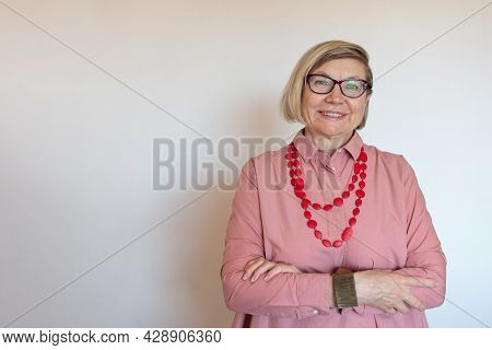 Happy Women Senior Fashionable Gray Hair, Middle Aged Smile Old Woman Wearing Glasses On A Light Bac