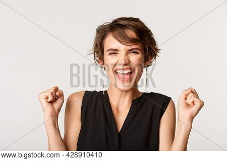 Close-up Of Ambitious Businesswoman Triumphing, Winning And Screaming Ecstatic