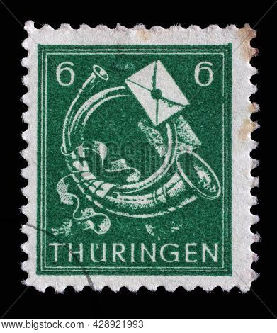 ZAGREB, CROATIA - SEPTEMBER 05, 2014: Stamp printed in Germany, Soviet Occupation of Thuringia, that shows Posthorn, circa 1945