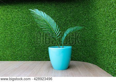 Flower In Vase, Vase Flower On Green Background. Vase Flower On Wooden Table. Wooden Table And Green