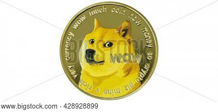 Dogecoin cryptocurrency isolated on white background - photo of Dogecoin crypto currency physical gold coin. Symbol icon of the doge meme coin.