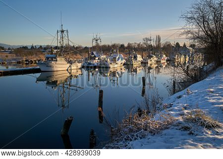 Richmond, British Columbia, Canada - February 22, 2018. Scotch Pond Dock Snow Steveston. Snow Covere